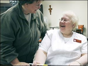 Sister Sharon Havelak, left, and Sister La Donna Pinkelman talk
