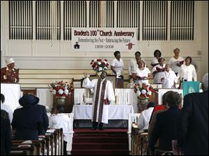 The Rev. Wynston Dixon, pastor, preaches at a recent service at Braden United Methodist Church at 2013 Lawrence Avenue.