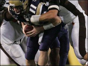 Bowling Green's Joe Schaefer sacks Akron's Chris Jacquemain during the fourth quarter to help the Falcons get the victory.