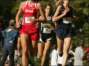 Central Catholic's girls' winner Kelly Karcher joins Whitmer's Logan Hamel at the head of the pack.