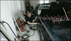 Al Compaan of Spencer Township has solar panels on his home, which he uses to charge his battery-powered vehicle.