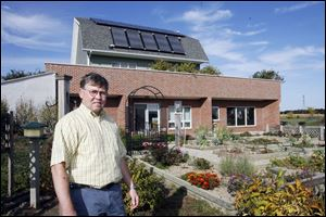 Ralph Semrock's home in Ottawa County, about 10 miles east of Oregon, has extensive insulation, energy-efficient appliances, and solar panels and a wind turbine to generate power.