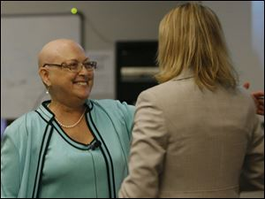 Dr. Jerri Nielsen, left, speaks with medical student Brooke Johnson after her talk at the UT college of medicine.