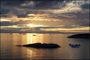 The midnight sun yields an array of colors. The island endures full days of darkness or daylight for months at a time.