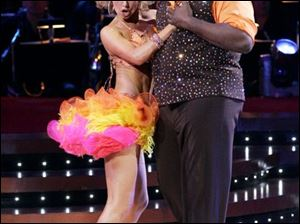 "Warren Sapp and Kym Johnson also grace the <a href="" http://www.ew.com/ew/article/0,,20231472,00.html"" target=""_blank  ""><font color=blue><b>'DWTS': A Field Guide to Tacky Fashion gallery</font color=blue></b></a>."
