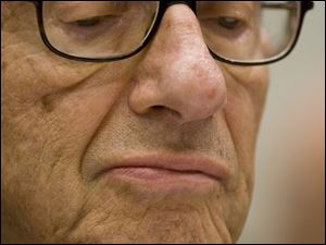 Former Federal Reserve Chairman Alan Greenspan pauses while testifying on Capitol Hill in Washington, Thursday.