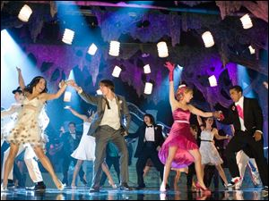 "In this image released by Disney Enterprises, from left, Vanessa Hudgens, Zac Efron, Ashley Tisdale and Jason Williams are shown in a scene from, ""High School Musical 3."""