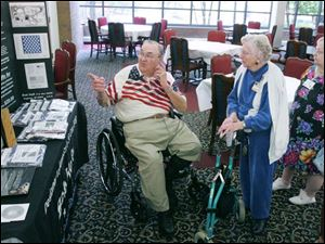 Bob Heft, designer of the 50-star flag, talks to senior citizens at Swan Creek Retirement Center.