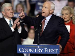Sen. John McCain is flanked by wife Cindy and Jack Kemp, 1996 GOP vice presidential candidate, at a rally near Dayton.