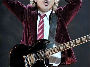 "AC/DC's Angus Young has a funny way of saying ""We're Number One."""