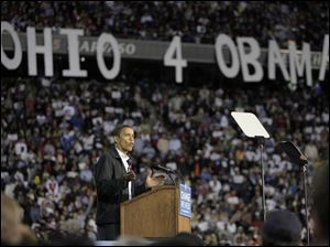 Democratic presidential nominee Barack braves rain to address crowd in Cincinnati.