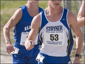 Stryker's Kenny Graber leads an Elmwood runner in the