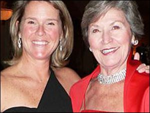 Daughter Lisa Silverman, left, and mom Nancy Metzger light up the Junior League anniversary.