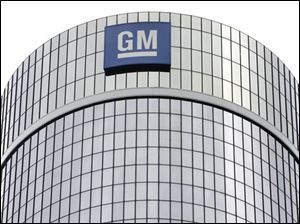 ** FILE ** In this July 25, 2008 file photo, General Motors Corp. headquarters are shown in Detroit. General Motors Corp. on Friday, Nov. 7, 2008 said it lost $2.5 billion in the third quarter and warned that it could run out of cash in 2009. GM also said it has suspended talks to acquire Chrysler, and said its cash burn for the quarter accelerated to $6.9 billion due to a severe U.S. auto sales slump. (AP Photo/Paul Sancya, file)