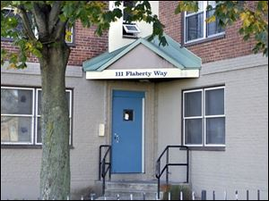 The door to the public housing complex in South Boston where D