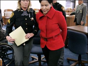Karyn McConnell Hancock leaves court after her plea. Sentencing is Jan. 15. She could receive up to eight years in prison.