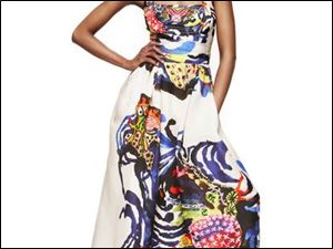 Wearable art is exemplified by French designer Christian Lacroixs wrap waist silk organza gown brush-stroked with a color-rich abstract print. Fashions like these will be featured at the Ebony Fashion Fair Sunday at the SeaGate Convention Centre.
