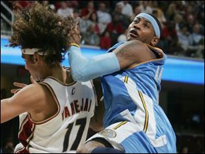 The Cavaliers  Anderson Varejao gets tangled up with Carmelo