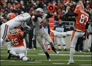 The Buckeyes  Malcolm Jenkins breaks through to knock away the punt by Anthony Santella. The play resulted in a safety.