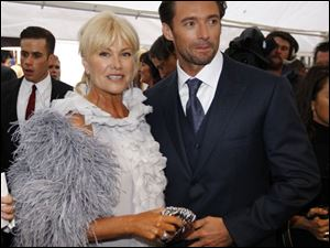 Australian actor Hugh Jackman walks the red carpet with his wife Deborra-Lee Furness during the world premier for his latest film <i>Australia</i> in Sydney, Australia.