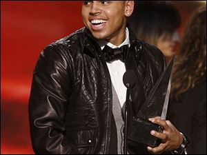 Chris Brown accepts the artist of the year award at the American Music Awards in Los Angeles on Sunday, Nov. 23, 2008.