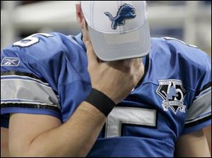 A dazed Drew Stanton had to leave the game after suffering a concussion in the fourth quarter of the Lions' 38-20 loss.