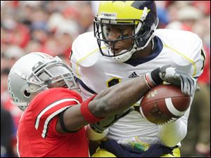 Ohio State's Malcolm Jenkins breaks up a pass intended for Michigan's Greg Mathews. The Buckeye seniors have a 43-7 record.