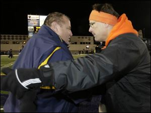 BGSU coach Gregg Brandon, right, shakes hands with UT coach Tom Amstutz after the Falcons' Friday night win. It was the last game for both coaches, as Brandon was fired yesterday.
