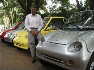Chetan Maini is the brains behind the REVA, a two-door hatchback selling for $8,000 to $10,000 with a top speed of 50 mph. He believes his company can sell 50,000 per year in five years.