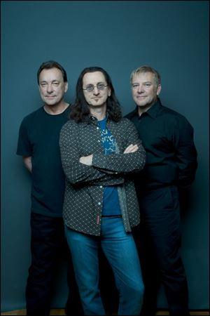 Rush is (l-r) Neil Peart, Geddy Lee, and Alex Lifeson.