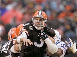 The Browns' Derek Anderson fumbles the ball after being hit by the Colts' Dwight Freeney. Indianapolis' Robert Mathis picked up the loose ball and ran it 37 yards for the game-deciding touchdown.