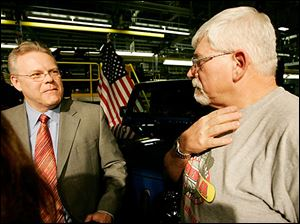 Chrysler LLC vice chairman Tom LaSorda, left, and Jeep worker Gary Stephens of Lambertville discuss the bailout plan.