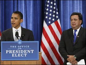 President-elect Barack Obama and Commerce Secretary-designate New Mexico Gov. Bill Richardson take part in a news conference in Chicago, Wednesday, Dec. 3, 2008.
