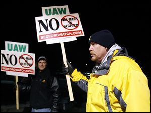 Charlie Cole, front, protests zoning changes in Bedford Township that some fear will pave the way for big-box stores.