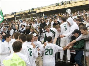 Ottawa Hills players celebrate with their fans after a 1-0 victory over Worthington Christian in Columbus gave the Green Bears the Division III state soccer title.