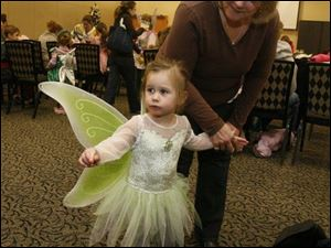 nbrn fairy04p 11/30/2008  blade photo by herral long   Ellie Nichols and grandmother Carol Nickoloff  both of monroe     dress up event  for the showing of the movie Tinker Bell at Bedford library
