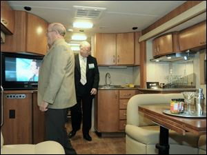 A bar sink is part of the luxury appointments in a buslike motor home at the annual show in Louisville.