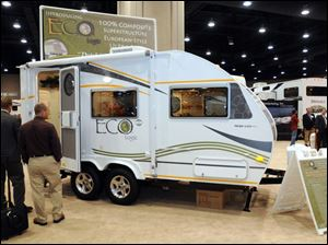 A towable RV features thermal-plastic walls, floor, and roof.