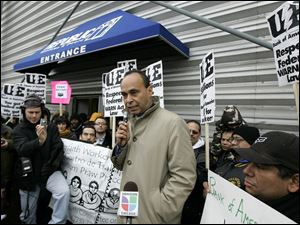 U.S. Rep. Luis Gutierrez, a Chicago Democrat, addresses protesters outside the Republic plant on Saturday.