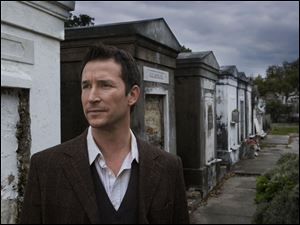 Flynn Carsen (Noah Wyle) tracks down a clue in one of New Orleans  above-ground cemeteries in  The Librarian: