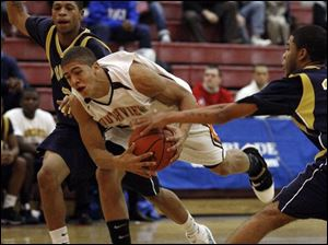 Southview's Jimmy Hall tries to split a pair of Columbus Brookhaven defenders last night at the Sullivan Center.