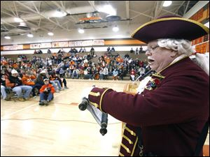 Michael Lieber, Sylvania town crier, reads a proclamation in honor of Southview's state football championship.