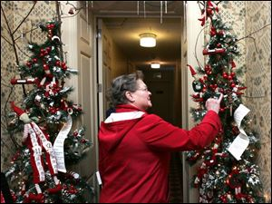 Mary Iott of Petersburg, Mich., reads Christmas wish lists as she tours the Manor House at Wildwood Metropark.