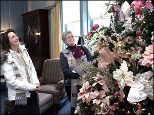 Toledoan Kaye Stephens, left, and Sue Cohen of Sylvania tour the displays at the 33rd annual 'Holidays in the Manor House.'