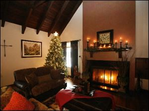 A fireplace is aglow in the home of  Dave and Diana Dittman.