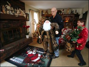 John and Carla Bocskay brighten their Deerfield home with holiday decorations in preparation for the upcoming tour of businesses, churches, and homes in the Petersburg area.