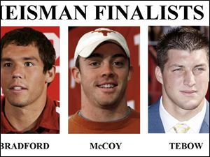 University of Florida s Tim Tebow, with 28 passing touchdowns and 12 more by rushing, can tie the only other two-time winner, Archie Griffin of Ohio State. Texas  Colt McCoy, called  Sinny  by teammates as a freshman, has grown into Heisman stature, gaining 30  pounds. Sam Bradford of Oklahoma directed the highest scoring team in major college football and led nation with 48 TD  passes.