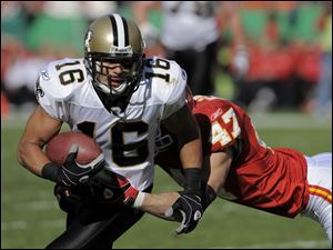 Saints wide receiver Lance Moore tries to shake free from Chiefs safety Jon McGraw on Nov. 16.