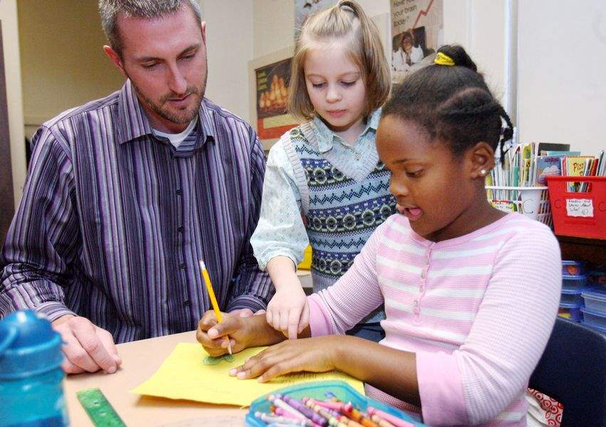 Girl-10-at-Christiancy-Elementary-helps-start-cards-for-soldiers-drive