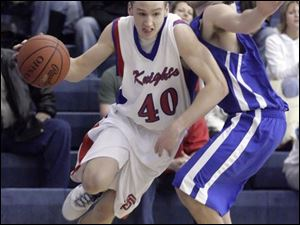 The Knights' Jake Szenderski (40) drives past Anthony Wayne's Jay Rezabek during the first quarter at the Knight Christmas Classic Friday night.